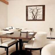 The chairs make this white dining room much more inviting.