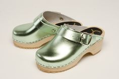 Metallic Mint Clog - Go Green. It's not easy being green - well, until now! Step into these mint metallic leather uppers and alder wood soled clogs. Includes moveable heel strap for children. Available in Children's sizes 24-34. Order here: http://store.capeclogs.com/childrens.aspx.