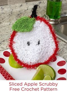 Sliced Apple Scrubby Free Crochet Pattern in Red Heart Scrubby yarn -- You will love how this little helper makes quick work of sticky kitchen clean ups! Crocheted in fast-drying polyester Scrubby, it washes easily by machine and dries quickly.