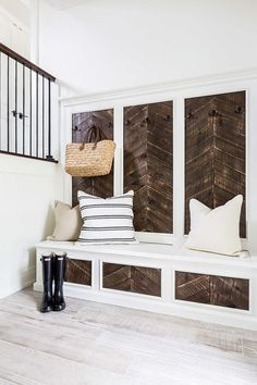 Love the reclaimed wood accent on this built-in! The herringbone style is beautiful. | 100+ Beautiful Mudrooms and Entryways at http://Remodelaholic.com