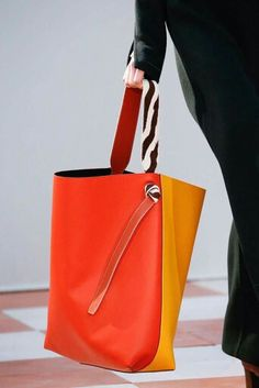 Introducing the Celine Fall/Winter 2015 Runway Bag Collection. Large tote bags in multiple bright colors like Red, Orange and Yellow were seen on the Tote Handbags, Tote Bags, Leather Handbags, Leather Bag, My Bags, Purses And Bags, Sacs Design, Celine Bag, Large Tote
