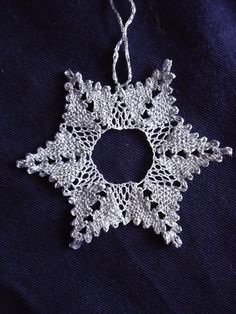 Bobbin lace Christmas snowflake star decoration with glitter thread star points