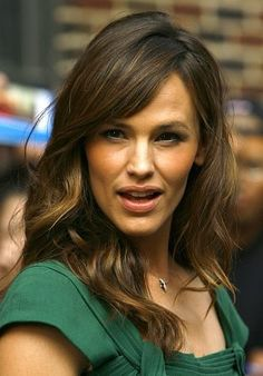 Stylish Wavy Hairstyles for Womens with Side Swept Bangs Hair from Jennifer Garner
