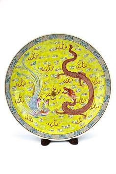 """A very large Chinese dragon & pheonix plate with yellow base from Qing """"Guang Xu"""" Six character """" Da Qing Guang Xu Nian Zhi"""" at the bottom.12 1/2'' D x 2 3/4'' H"""