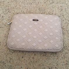 NWOT Tumi Laptop sleeve Never been used! Original paper still inside. Tumi Accessories