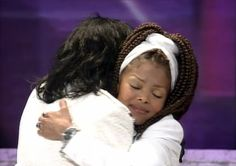 Janet and Michael Jackson having a loving moment at the Grammy Legend Award.