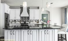 This island is made entirely out of functional Waypoint cabinetry giving plenty of extra storage for the whole family.  Visit https://www.zelmarkitchendesigns.com for more design ideas.