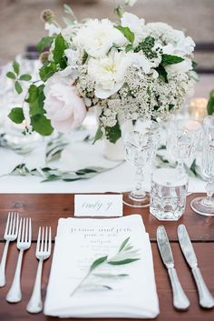 Elegant white place setting at a reception in Italy.