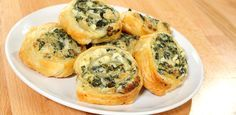 Creamy Spinach Roll Ups - 8 oz. Cream Cheese  8 oz. Monterey Jack Cheese Shredded  1/4 tsp Garlic Powder  1/4 Yellow Onion Diced Smal 10 oz. Package of Frozen Spinach, Thawed and Drained Really Well  1 Box of Puff Pastry Sheets (2 Sheets)  1 Egg  1 Tbsp. Water