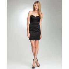 Bebe Little Black Dress Bebe Madden Seam Detail Satin dress: Heart shape neckline, satin form fitting material with seam details, light bra support; perfect for a night out. Strap not included to go around the neck. Size small or 0-4 bebe Dresses Strapless