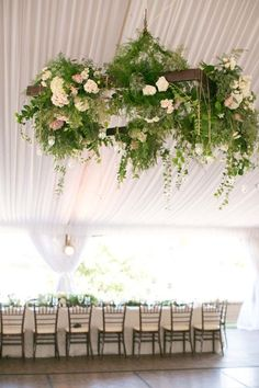 Wedding Trends on trend: hanging floral arrangements - 12 wedding trends that are so hot, right this second. Hanging Flower Arrangements, Hanging Flowers Wedding, Wedding Flower Decorations, Wedding Flower Arrangements, Reception Decorations, Floral Arrangements, Flowers Decoration, Flower Chandelier, Chandelier Wedding