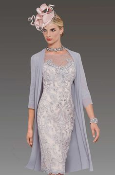 This short fitted dress has a beaded lace design. The back of the dress has covered buttons from the waist upwards which conceals the zip. It features an illusion sweetheart neckline which is adorned by delicate beads. The lace detailing is also featured on the three quarter sleeves. It comes with a matching chiffon coat. …