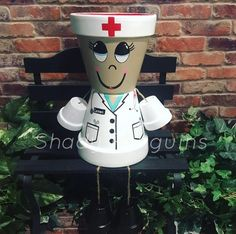 Excited to share this item from my shop: Nurse Flower Pot/ flower pot/ indoor decor/ outdoor decor/ garden statue/ birthday gift/ fall decor/ flower pot people/ clay Flower Pot Art, Flower Pot Design, Clay Flower Pots, Flower Pot Crafts, Painted Clay Pots, Painted Flower Pots, Hand Painted, Decorated Flower Pots, Flower Pot People