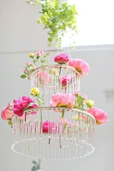 Pink flowers mixed with test tubes create a chandelier | via @intimatewedding