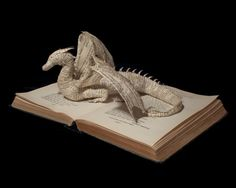 Dragon guarding a book - made from the actual pages of a book. What a creative sculpture!