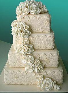 Square, 4-tiered white wedding cake.