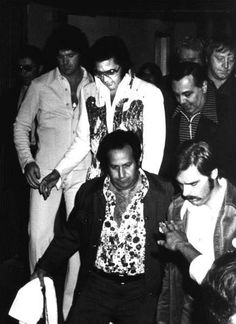 Elvis on his way to his afternoon show in Philadelphia in june 23 1974 here with Joe Esposito and others members of the Elvis mafia.