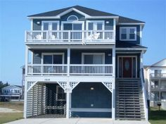 'Serenity Now' is a 7 bedroom vacation rental home located in Kill Devil Hills, Nc. Pet friendly, elevator, private heated pool, tiki bar in pool area, hot tub, whirlpool tubs.  Managed by Village Realty.  Property I.D. is KD12