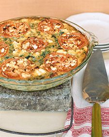 Zucchini Pie - Marjoram, with its hint of balsam, complements mild yellow and green summer squash in this simple crustless zucchini pie. It is topped by tomato slices and low-fat feta cheese, a lean choice. If yellow zucchini are unavailable, use all green zucchini.Return to Healthy Greek Menu.