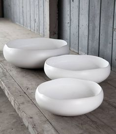 "white ""St. Ives Ceramic Bowls"" with an irregular frame 