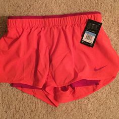 Nike training shorts ⚡️ Nike orange with red accent running shorts. Only took out of bag to photograph. Nike Shorts