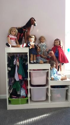 Storage for American Girl Dolls from Ikea storage.  Half inch dowel rods used in track for hanging.