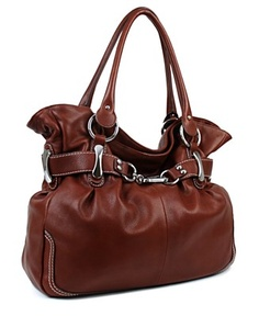 I have this in the brown crocodile embossed version and have carried it on and off for 3 seasons. Still looks like new. B. Makowsky Belfast Shopper Tote