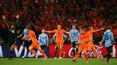 CAPE TOWN, SOUTH AFRICA - JULY 06: The netherlands celebrate as the final whistle is blown during the 2010 FIFA World Cup South Africa Semi Final match between Uruguay and the Netherlands at Green Point Stadium on July 6, 2010 in Cape Town, South Africa. (Photo by Ryan Pierse - FIFA/FIFA via Getty Images)