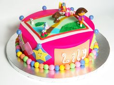Dora cake - I made this Dora the Explorer cake for my youngest child's second birthday. I showed her some cake pics from CC, and she fell in love with Bel_Anne's Dora's Map cake, so I blended that design with that of several other Dora cakes that I found on this site. Thanks for the inspiration, guys. Unfortunately, things were too hectic around the house to allow me enough time to make the Dora and Boots figures. I did make Swiper though, and that sneaky fox is trying to swipe the mini-cake…