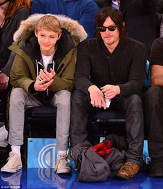 Timely escape: Norman Reedus got a chance to relax at the NY Knicks game at Madison Square Garden with 15-year-old son Mingus on Monday following THAT midseason finale on The Walking Dead  @maprada