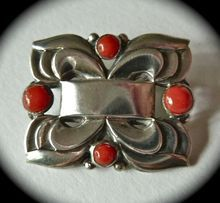 Coro Norseland Sterling Pin w Genuine Coral / by Coro from their higher end Norseland* line of silver jewelry made in the Arts and Crafts and Art Deco styles /The rectangular pin has a layered geometric deco design, the open areas add to the distinction and depth of the pin / Four genuine red coral cabochons are bezel set with one on each /The solid back is clearly marked Sterling, Genuine Norseland with the Viking Ship logo / c1930s /75