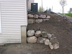 retaining walls made of boulders - for under the deck around the patio