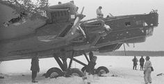 Finnish soldiers and Soviet bomber. Possibly taken during the Winter War of 1939-1940.
