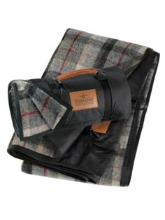 Pendleton Woolen Mills: ROLL-UP BLANKET...great for concerts or sporting events on the cold damp ground.