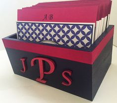 """Fuschia and Navy Wedding Guest Book Box and Cards is the perfect size, the box is 6-1/2"""" x 4-3/8"""" and 2-7/8"""" height to display at your wedding and new home as a married couple. Each box is made from poplar wood, handpainted and sealed with a clear gloss varnish. The box is trimmed with a fuschia ribbon and color coordinated hand painted wood couple monogram (Photo displays Lucida Calligraphy font for monogram)."""