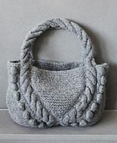 Felted Bag with Cables and Bobbles by Lana Grossa ... FREE pattern via Ravelry............ huh... and I purchased the magazine last year!!  lol  oh well, knit in bulky 12ply and felted!