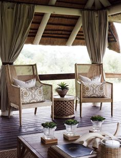 Inspiration for African Colonial Decor with a contemporary twist - love the touch of green potted plants!