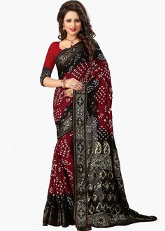 This #black and #red #cotton #silksaree comes with all over #bandhej work and #zari border.