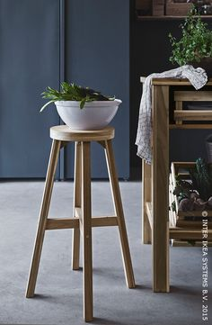 Use a stool for the fern plant in the bathroom!  Love this.