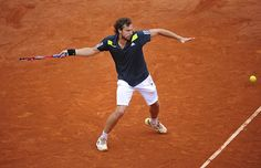 Ernests Gulbis fires one back against No.4 seed Roger Federer in the Round of 16.