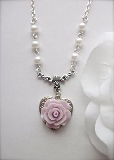 Lavender Rose Pendant Necklace, Light Purple Rose Silver Heart Pendant Necklace, Rose Flower Jewelry, Romantic Gift for Her, Floral Necklace  This lovely rose necklace features heart shape well ornate bright silver plated pendant, adorned with beautiful very detailed light purple rose cabochon, dangle from delicate antiqued silver Victorian style connector. It comes with a 20 inches silver tone faux pearl and link chain closes with lobster clasp. Ready to wear immediately or give as a gift…