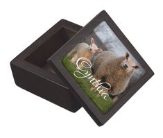 Small wooden box with sheep and lamb photo on lid. Add a name in white script and gift to a knitter or crafter. This little box would be perfect for storing knitting notions such as stitch markers, counters, tapestry needles and other small items. #giftsforknitters #personalizedbox #trinketbox #stockingstuffer