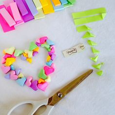 Make origami puffy hearts using Post-it page markers.