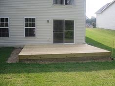 Simple wood patio - would add planters and landscaping to this design - and stairs on the left