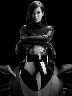 """New T-Mobile Ad Campaign – Alter Ego with Carly Foulkes  T-Mobile unveiled its redesigned """"Alter Ego"""" advertising campaign. In an attempt to redefine the company as a cutting-edge carrier with a speedy wireless network, Foulkes now sports a black leather motorcycle suit on a matching Ducati superbike. Photography by Caesar Lima"""