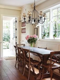 Cottage Dining Room with Restoration hardware madeleine side chair, Magnussen lybrook console table, Chandelier, Window seat