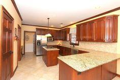 Craftsman Kitchen with Stone Tile, six panel door, can lights, limestone tile floors, U-shaped, Crown molding, Limestone Tile