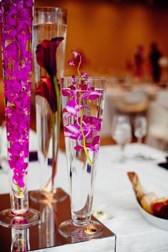 Beautiful submerged orchids make for this stunning mirrored tablecentre