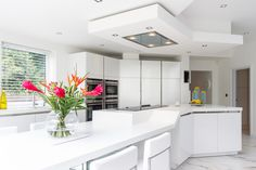 this split island unit by Stuart Frazer cleverly creates two distinct areas in the SieMatic kitchen: one for cooking and one for eating Life Kitchen, Kitchen Ideas, Slg, Corian, Minimalist Design, Lotus, Extensions, Kitchens, The Unit
