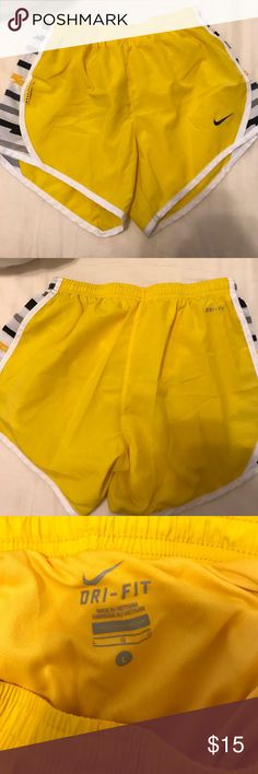 Nike Livestrong shorts dri-fit yellow shorts from nike with black yellow and white patterns. size L (GIRLS) not women's. don't wear anymore and still in great condition!! Nike Shorts